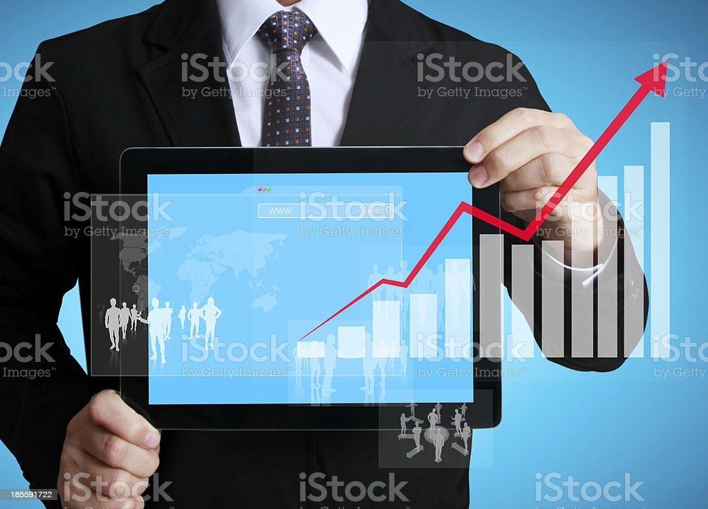 A male businessman showing graphic on a touch screen tablet royalty-free stock photo