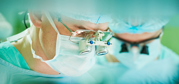 istock male cardiac surgeon at child cardiosurgery operating room 530439678