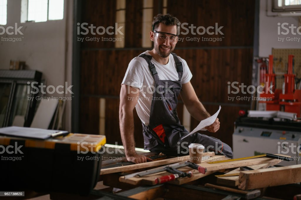 Male carpenter in his craft workshop. Shallow DOF. Developed from...
