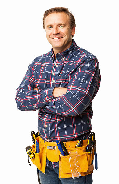 male carpenter standing confidently with a utility belt - isolated - tool belt stock photos and pictures