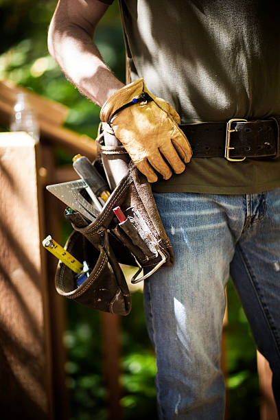 male carpenter wearing tool belt. - tool belt stock photos and pictures