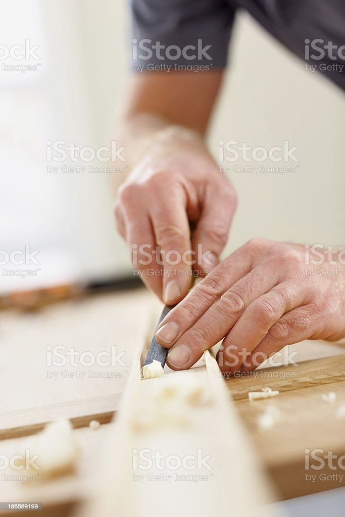 Male carpenter's hands working on wood stock photo