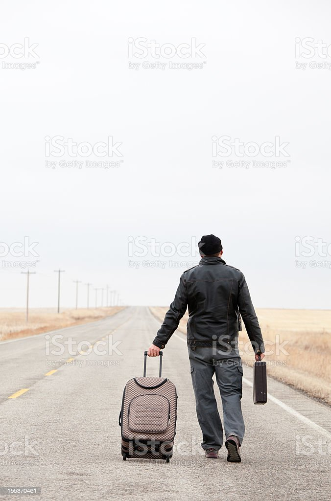 Male Caucasian Business Traveler With Luggage Walking royalty-free stock photo