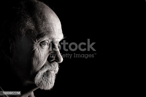 Male caucasian intense close up portrait in black and white, harshly processed