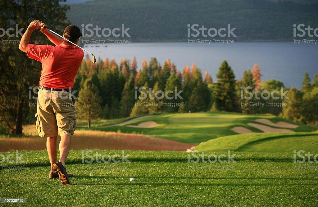 Male Caucasian Golfer On The Tee stock photo