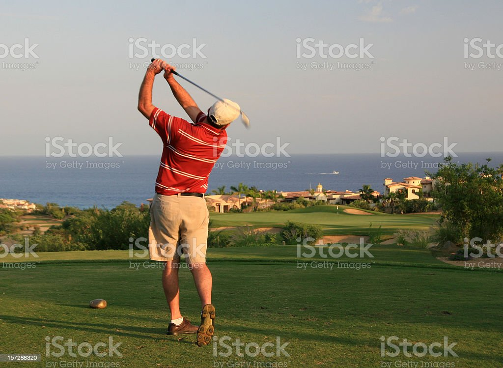 Male Caucasian Golfer Swinging in Mexico royalty-free stock photo