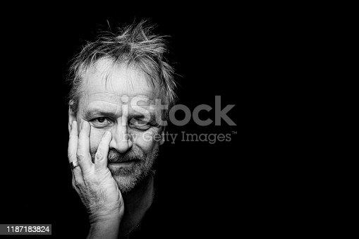 Male caucasian intense close up portrait in black and white, portrait