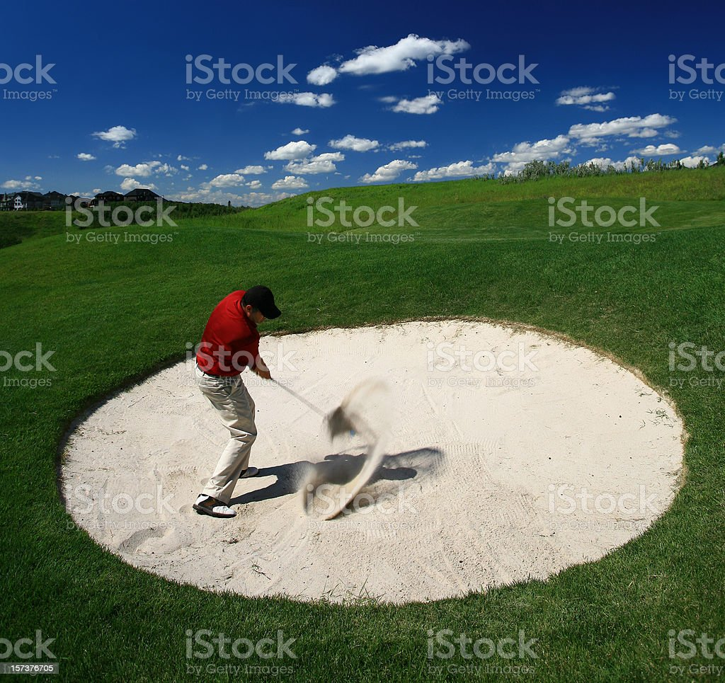 Male Caucasian Playing Bunker Shot royalty-free stock photo
