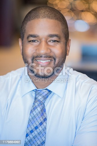 538177146 istock photo Male CEO smiling 1179884992