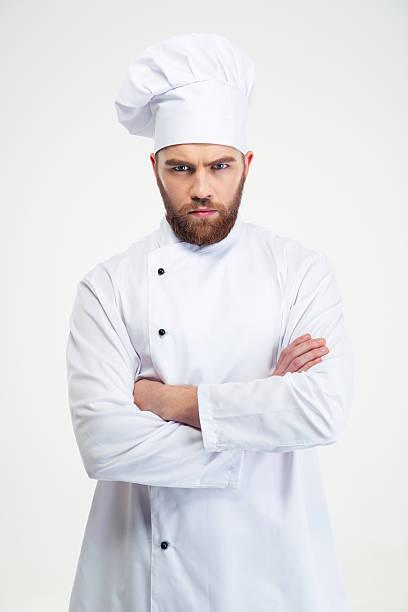 maschio chef cucinare in piedi con le braccia piegate - chef triste foto e immagini stock