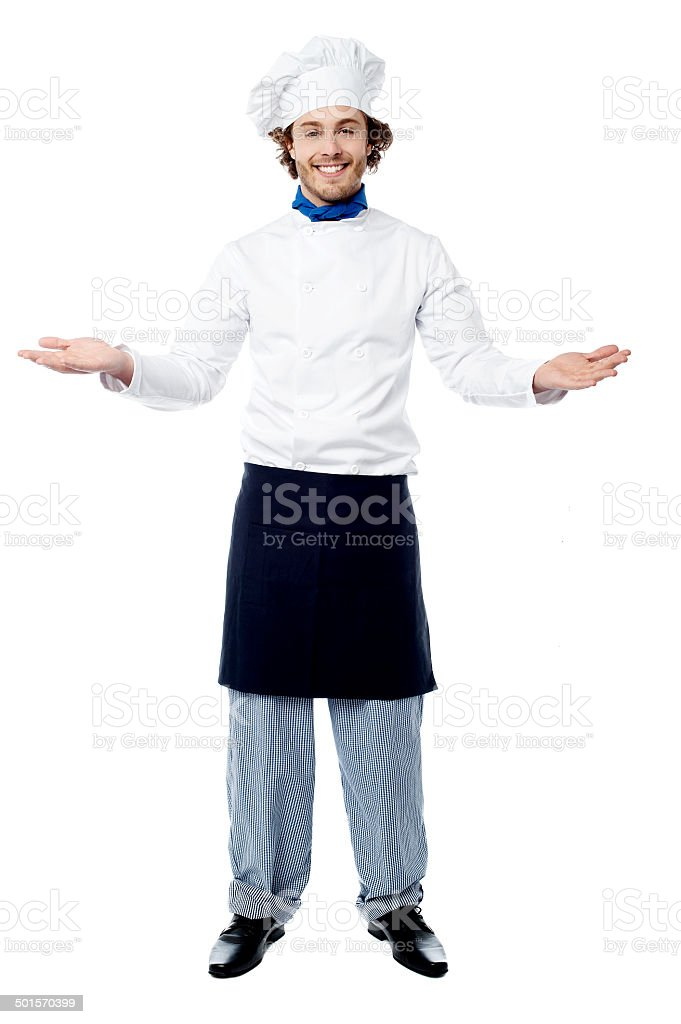 Male chef in uniform welcoming guests - Royalty-free Adults Only Stock Photo