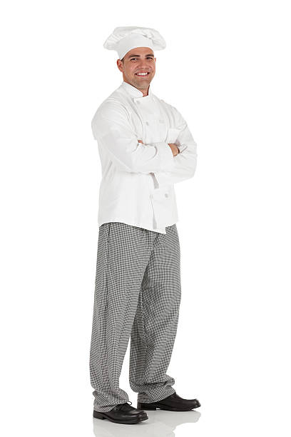Male chef standing with his arms crossed Male chef standing with his arms crossedhttp://www.twodozendesign.info/i/1.png chef's whites stock pictures, royalty-free photos & images