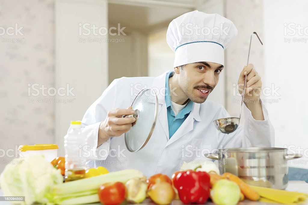 male chef tasting soup with ladle royalty-free stock photo