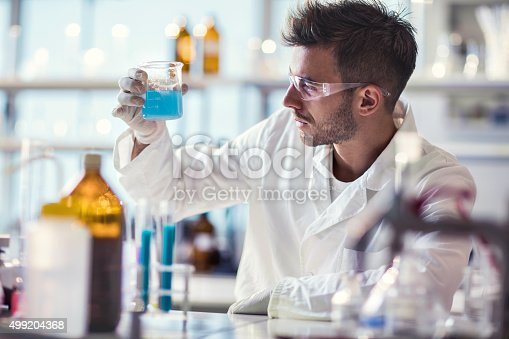 istock Male chemist working on chemical substances in a laboratory. 499204368