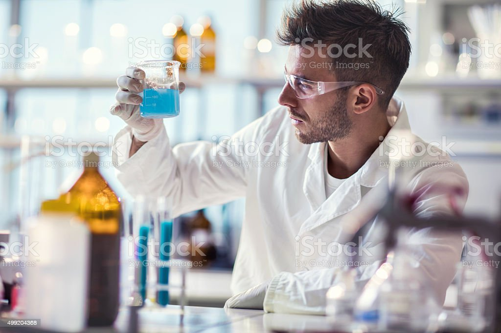 Male chemist working on chemical substances in a laboratory. stock photo