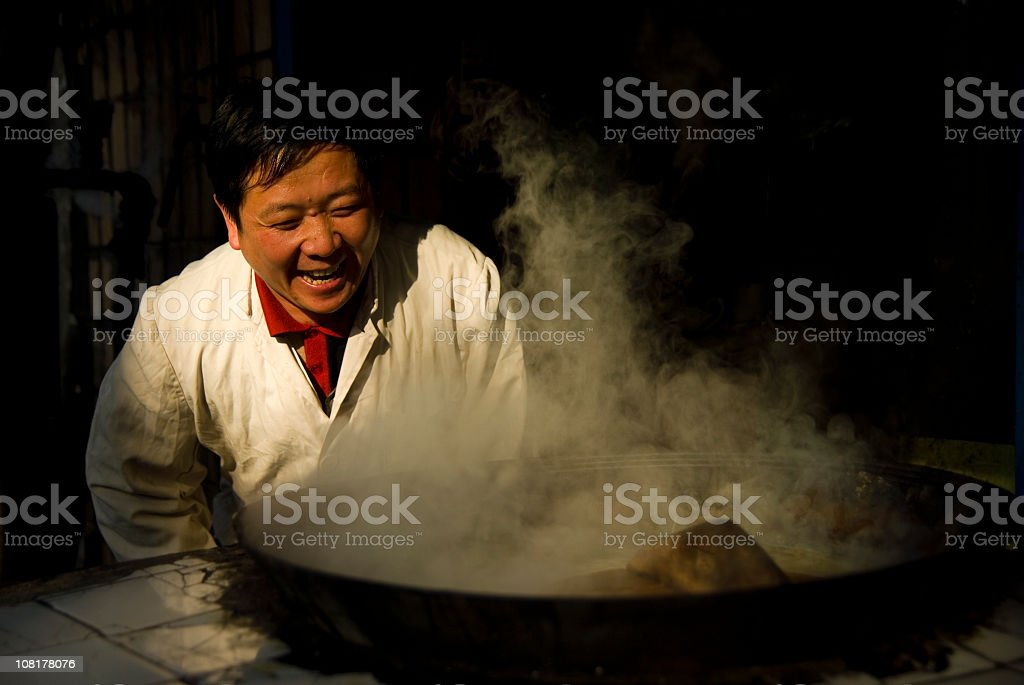 Male Chinese Chef Standing by Large Pot stock photo