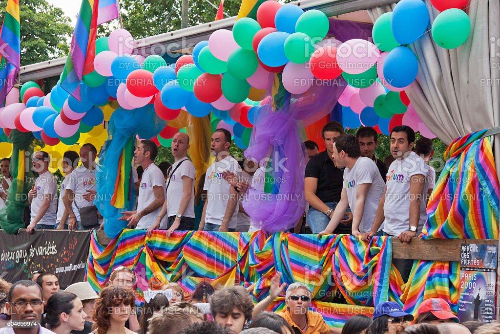 Male choir singing in a Gay Pride parade through Paris stock photo