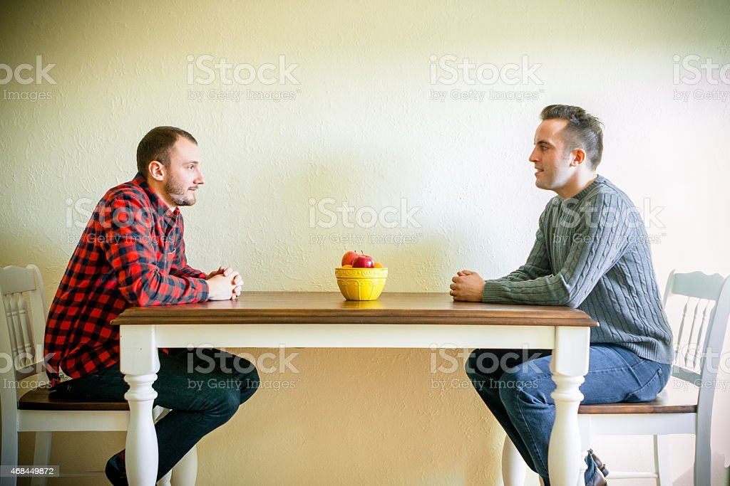 Male Client Talking and Responding to his Life Coach stock photo