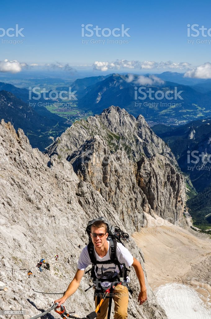 Male climber at Höllental (Hoellental) valley on the way up to Zugspitze (2962m), Germany's highest mountain in the Bavarian Wettersteingebirge. Höllental glacier is on of only 5 glaciers in Germany. stock photo