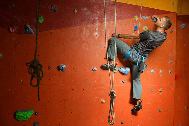male climber on climbing gym, indoor. – Foto
