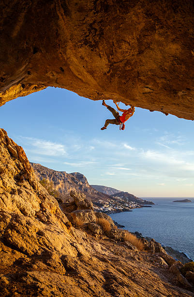 Male climber on overhanging cliff stock photo