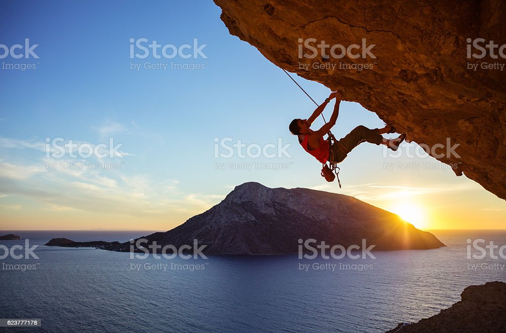 Male climber on overhanging rock stock photo