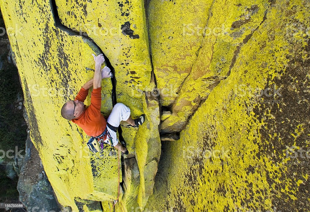 Male climber working his way up a steep crack. royalty-free stock photo