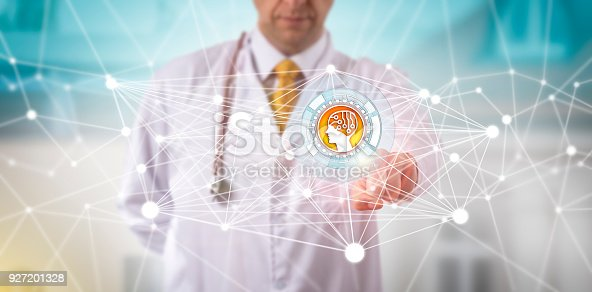 istock Male Clinician Initiating An AI APP In A Network 927201328