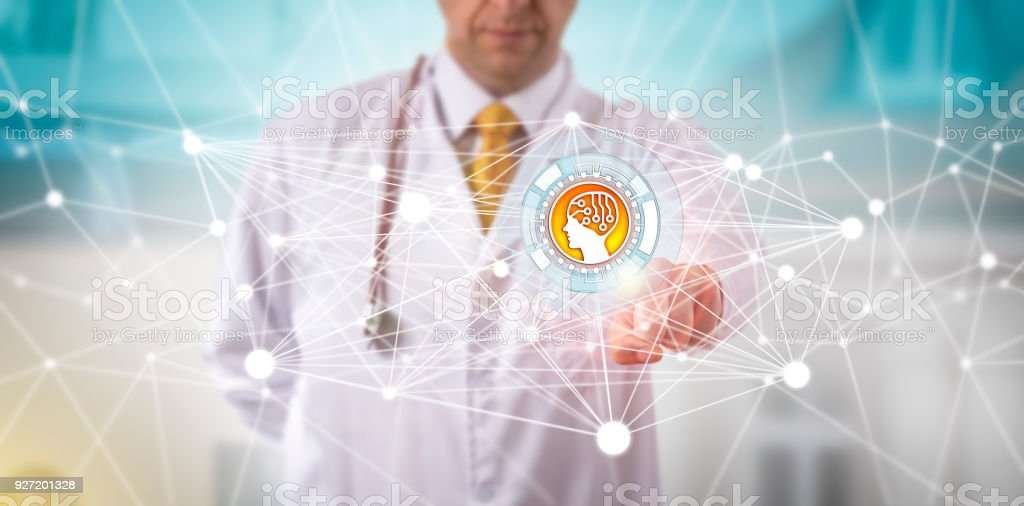 Male Clinician Initiating An AI APP In A Network stock photo