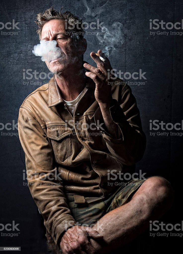 HDR Male Cloud Of Cigarette Smoke Studio Shot