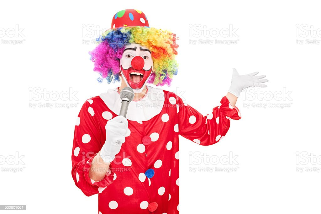 Male clown speaking on a microphone stock photo