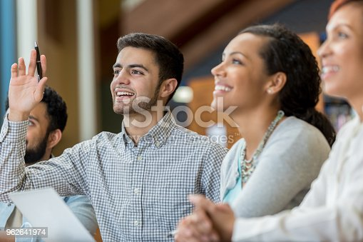 600055398 istock photo Male college student asks question during class 962641974