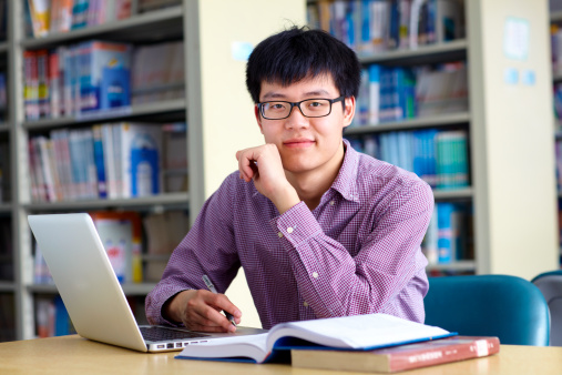689644378 istock photo A male college student studying in a library 172376212