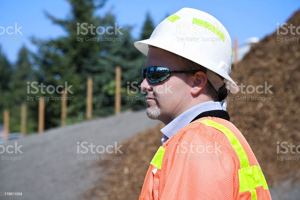 Male Construction Project Manager with safety gear yellow reflective royalty-free stock photo