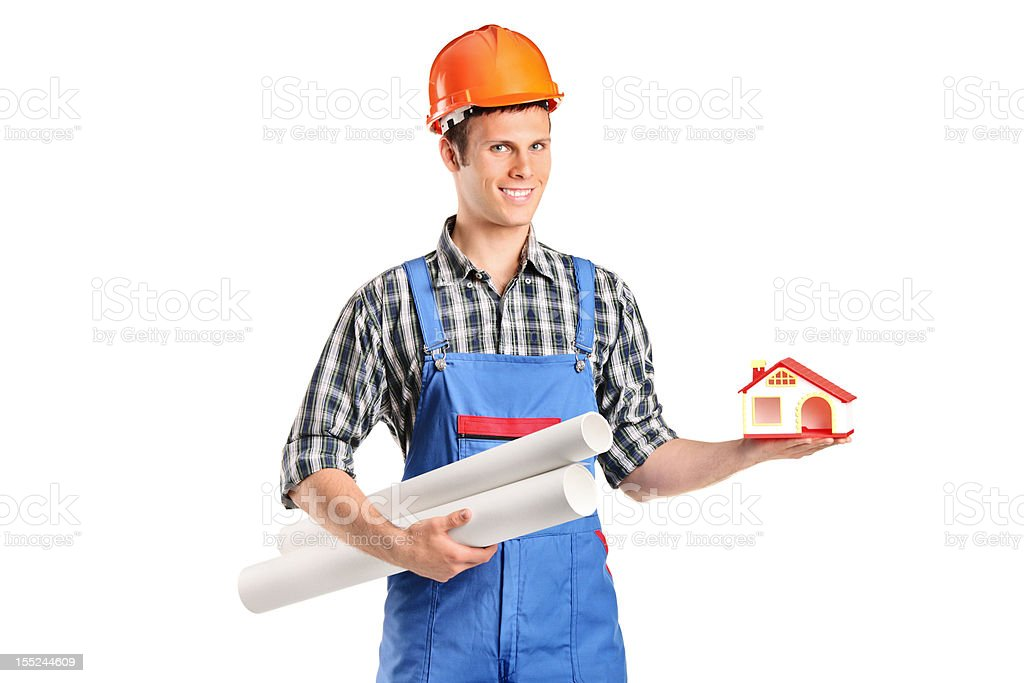 Male construction worker holding a model of house and blueprints royalty-free stock photo