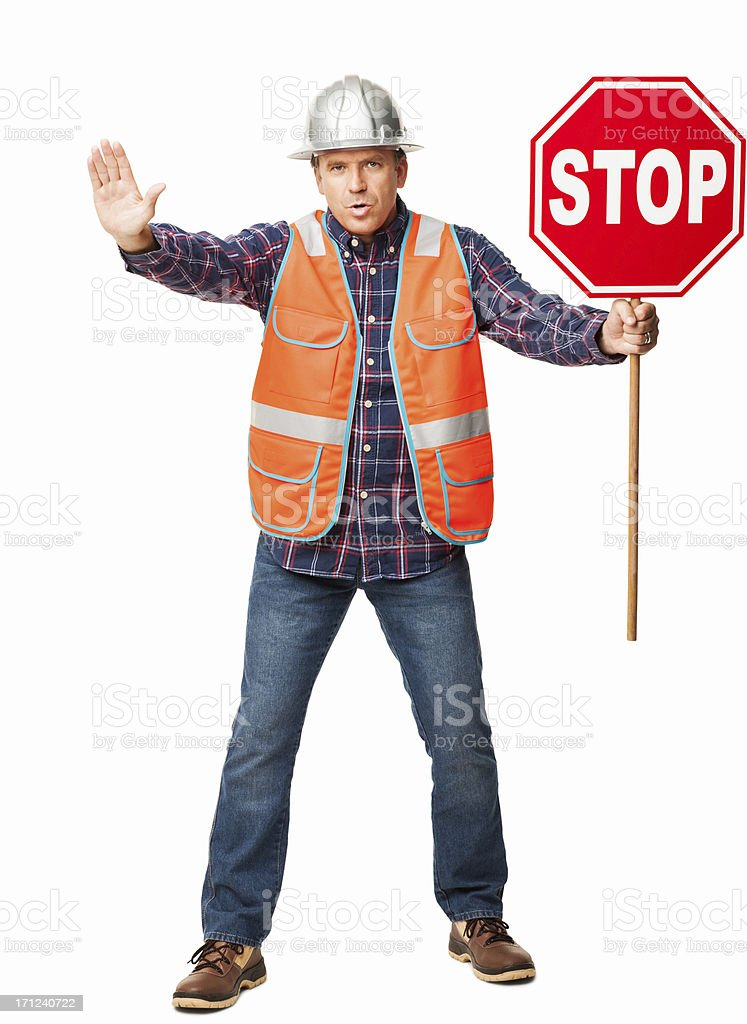 Male Construction Worker Holding a Stop Sign - Isolated royalty-free stock photo