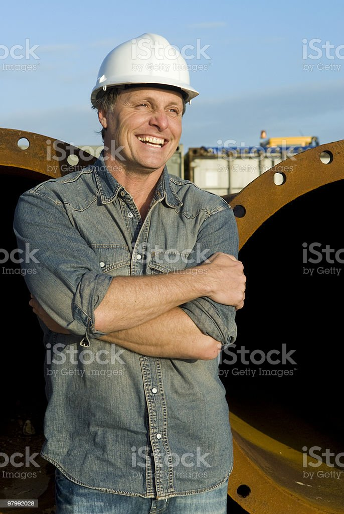 Male construction worker on job site smiling royalty-free stock photo