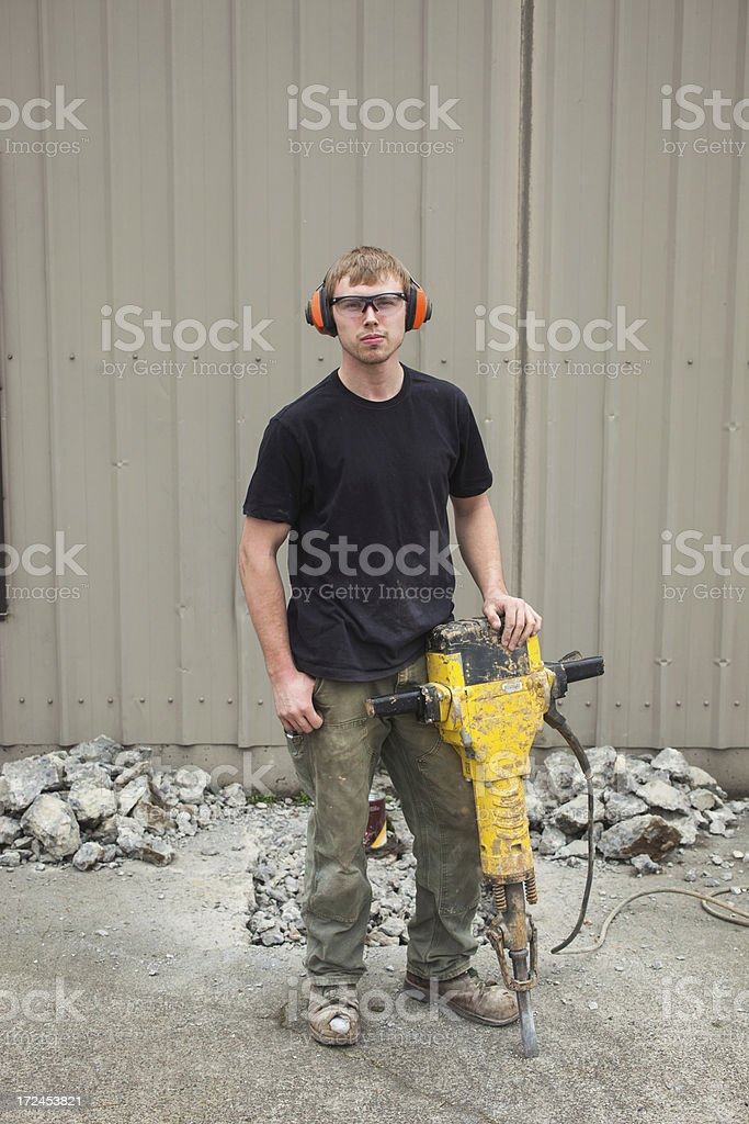 Male construction worker using a jackhammer royalty-free stock photo