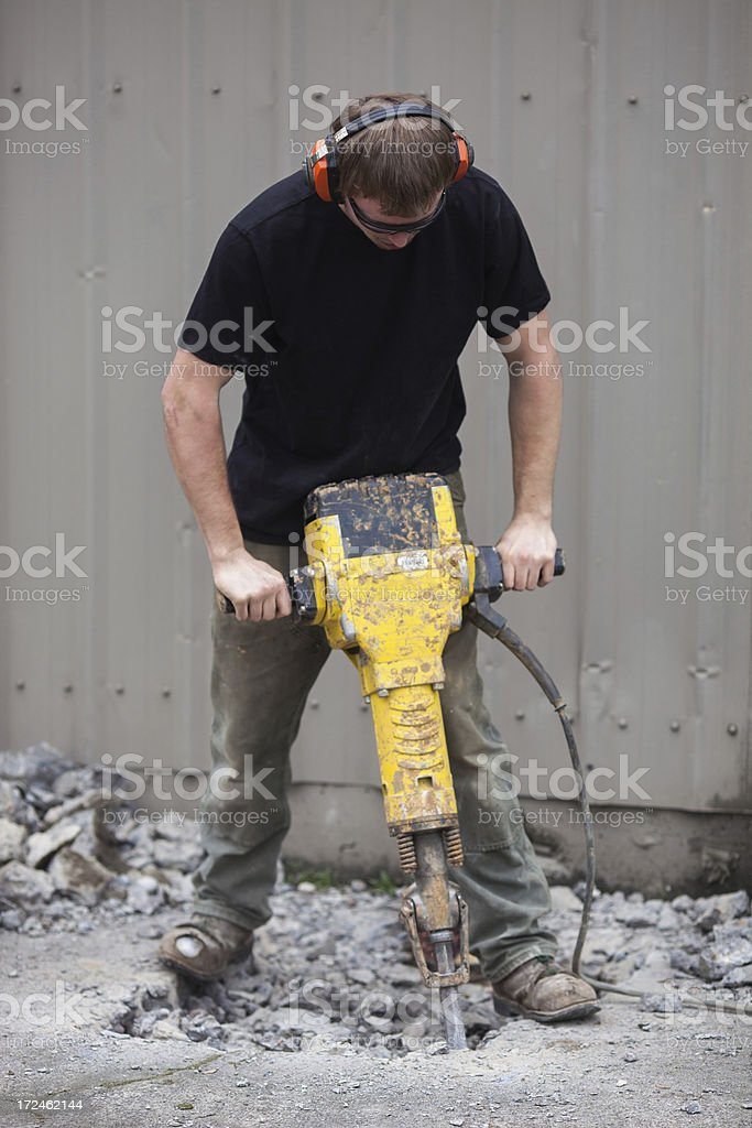 Male construction worker using a jackhammer. stock photo