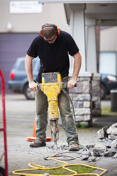 Male construction worker using a jackhammer stock photo