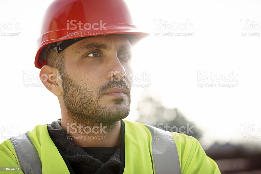 Male construction worker wearing hardhat looking away royalty-free stock photo