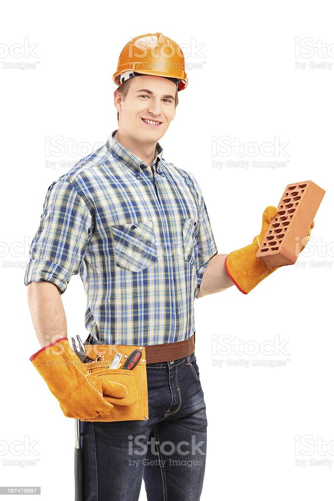 Male construction worker with helmet holding a brick royalty-free stock photo