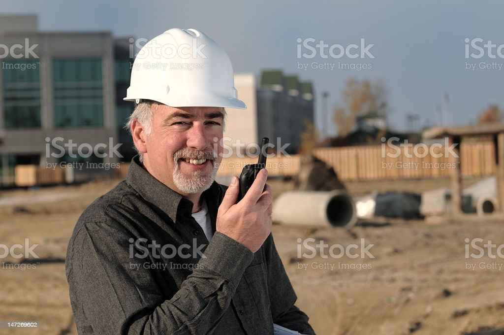 Male construction worker with two way radio royalty-free stock photo
