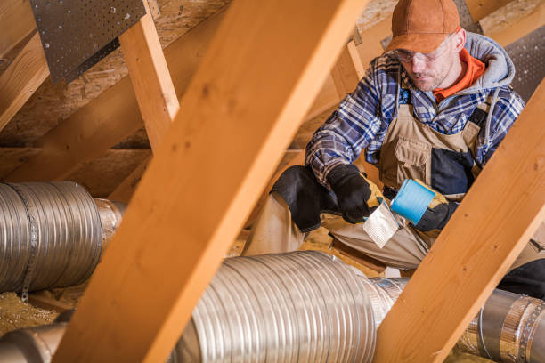 Male Contractor Binding Ventilation Pipes With Duct Tape. stock photo