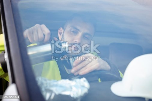 istock Male contractor having a coffee break 180722991