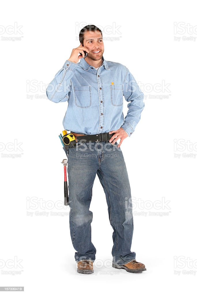 Male contractor talking on the phone stock photo