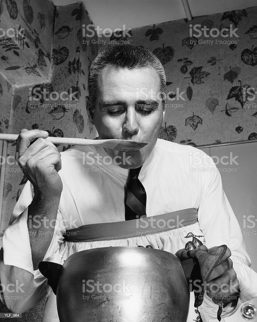 Male cook tasting food royalty-free stock photo