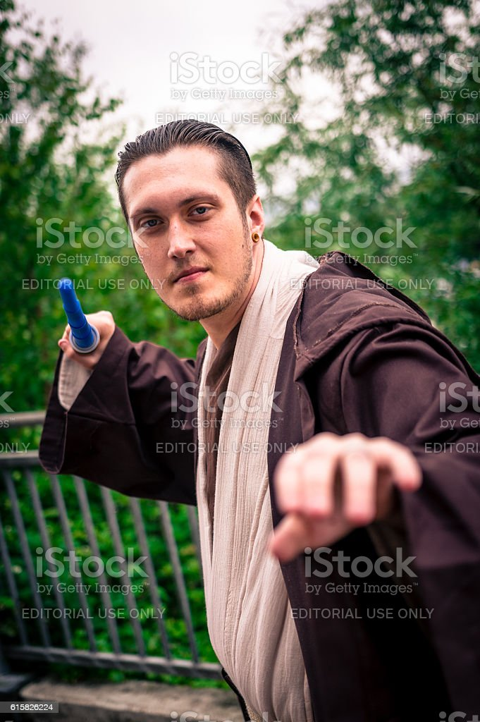 Male cosplayer dressed as a Jedi from 'Star Wars' stock photo