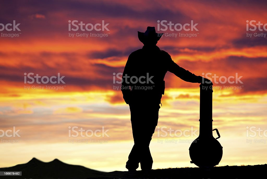 Male Country Musician Silhouette stock photo