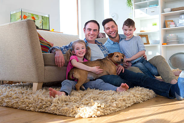 male couple posing with son, daughter and dog - homosexual stock photos and pictures